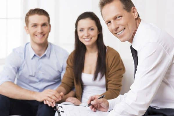 Insurance Agent With Young Couple
