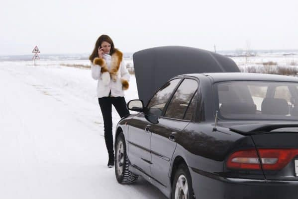 Woman Standing by Brokedown Car