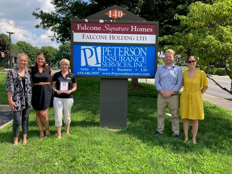 Peterson Insurance Staff Holding Love Award Plaque